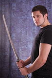 Man and katana Royalty Free Stock Photography