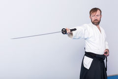 A man with katana on Iaido practice Stock Photography