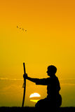 Man with katana. Illustration of man with katana at sunset Stock Images