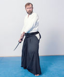 A man with katana is ready to attack Stock Photography