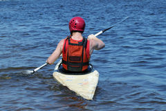 Man in a kayak Stock Images