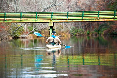 Man in Kayak / Bridge Royalty Free Stock Images