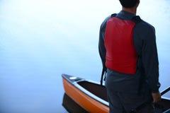 Man with kayak on calm lake Royalty Free Stock Photo