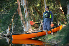 Man with a kayak in the forest wilderness Stock Images
