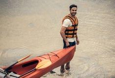 Man and kayak royalty free stock images