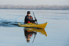 Man with the kayak stock images