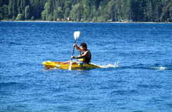 Man in kayak in a lake Royalty Free Stock Photos