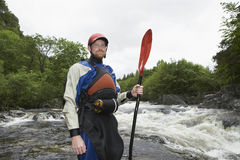 Man With Kayak Oar Against River Stock Images