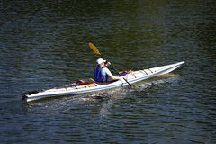 Man in kayak paddling. Stock Photos