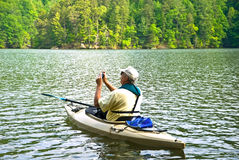 Man In Kayak Stopping To Take Photo Stock Image