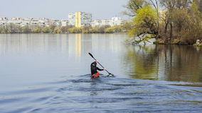 A man kayaking on a background of the city, turn to kayak Stock Image