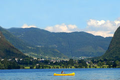 Man kayaking on bohinj lake Royalty Free Stock Images