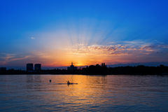 Man in kayaking on Lake at sunset Stock Photos