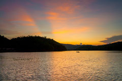 Man kayaking on Lake at sunset, Kanchanaburi, Thailand Royalty Free Stock Image