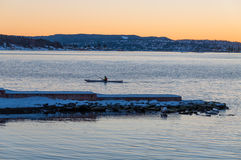 A man kayaking in Oslo fjord in winter, Norway Stock Photos