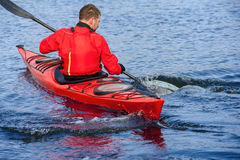 Man kayaking on the red kayak on the river 10 Royalty Free Stock Images
