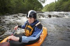 Man kayaking in river Royalty Free Stock Images