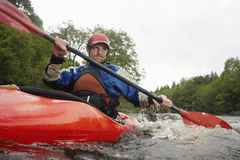 Man kayaking in river Stock Photos
