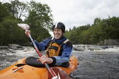 Man kayaking in river Royalty Free Stock Images