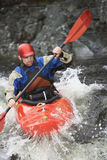 Man kayaking in river Stock Photos