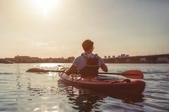 Man kayaking on sunset royalty free stock photos