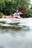 Man kayaking Stock Images