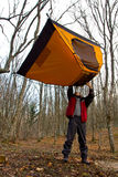 Man keep tent over head Royalty Free Stock Images