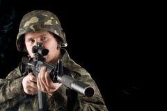 Man keeping a gun in studio Stock Images