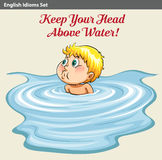 A man keeping his head above the water Stock Images