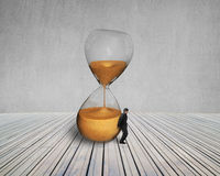 Man keeping the tilt hourglass Stock Images