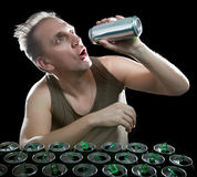 The man keeps a can of beer in a hand Stock Photos