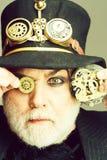 Man keeps cogwheel and gears royalty free stock image