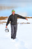 Man with  kettle. Campaign on altai, pass a warm key Stock Photo