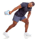Man kettle bell. African man exercising with kettle bell on white background royalty free stock photos