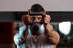 Man And Kettle Bell Stock Photography