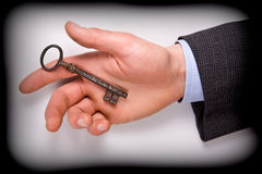 Man with key. Business man hold key of success in his hand Stock Images