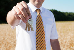 Man with key on hand Royalty Free Stock Photo