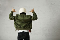 Man in a khaki pilot jacket with helmet Stock Photography