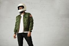 Man in a khaki pilot jacket with helmet Royalty Free Stock Photography