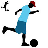 Man Kicking Ball Royalty Free Stock Images