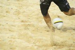 Man kicking beach ball Royalty Free Stock Photo
