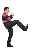 Man kicks by leg Royalty Free Stock Image