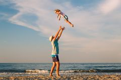 Man with kid outdoors stock photo