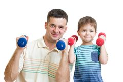 Man and kid son doing exercise with dumbbell Stock Photo