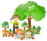 Man and kids planting trees Royalty Free Stock Photo