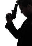 Man killer policeman holding gun portrait silhouette stock photography