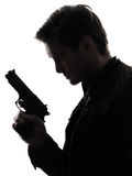 Man killer policeman holding gun portrait silhouette Royalty Free Stock Photography