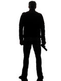 Man killer policeman holding gun walking silhouette Stock Photos