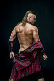 Man in kilt. Muscled male model in kilt