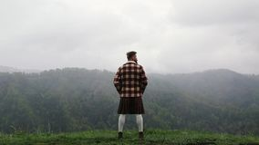 Man kilt with mustache beard mountain. Looking back. Snow. Fog caucasian stock video footage